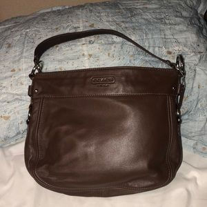 Brown medium sized coach bag with blue interior